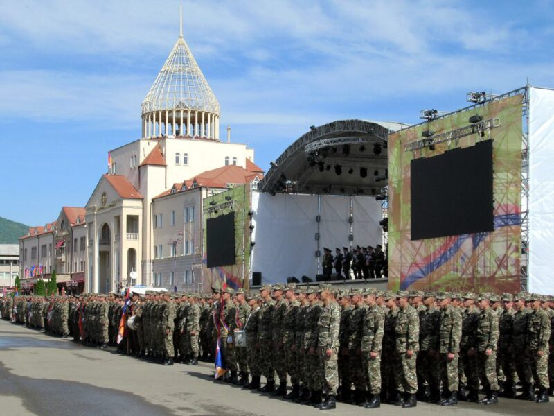 Nagorno Karabakh Defense Army troops assemble before the National Assembly building on Renaissance Square in Stepanakert.