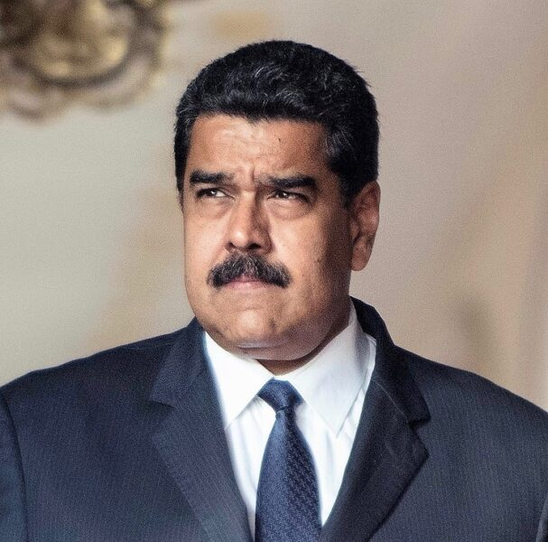 President Nicolás Maduro, from the shoulders up. He's in a dark, pinstriped suit and looks off to the left.