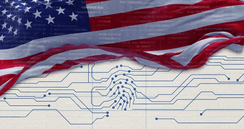 An American flag waves over a circuitboard pattern. Binary code is superimposed faintly over the stars and stripes.