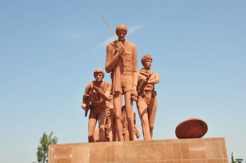 The Martyr's Memorial Monument in Mekele, a copper-colored statue of several curly-haired revolutionaries advancing across a plinth.