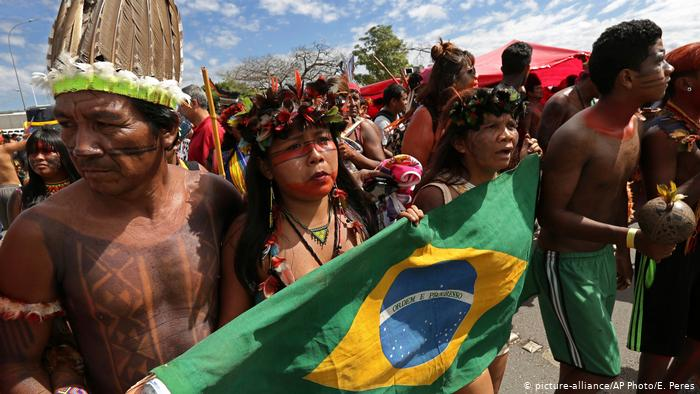 Indigenous people protesting infringements of their land rights in Brazil