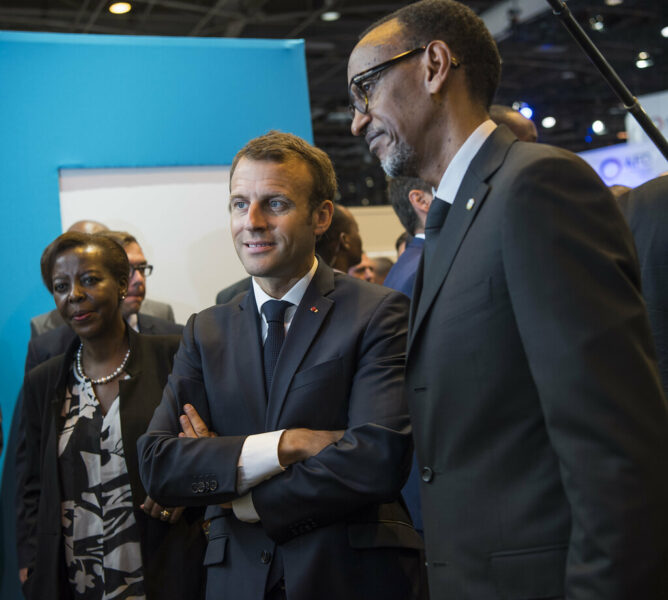 Presidents Macron and Kagame at a Paris tech convention in 2018.
