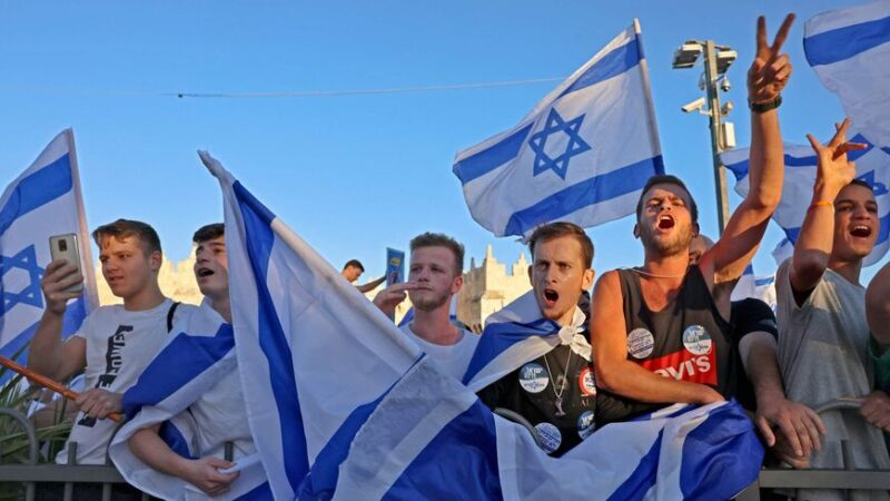 Israeli youths gesture during the ultranationalist March of the Flags outside Damascus Gate in Jerusalem's Old City, on June 15, 2021, celebrating the anniversary of Israel's 1967 occupation of Jerusalem's eastern sector. (Photo by EMMANUEL DUNAND / AFP) (Photo by EMMANUEL DUNAND/AFP via Getty Images)