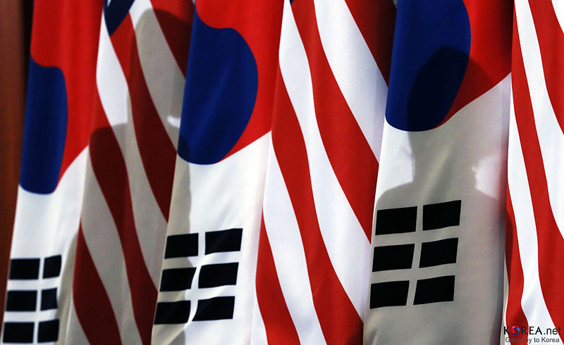 A banner made with stripes alternating between the American and South Korean flags.