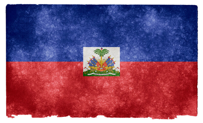 A scuffed and battered-looking rendition of the Haitian flag.