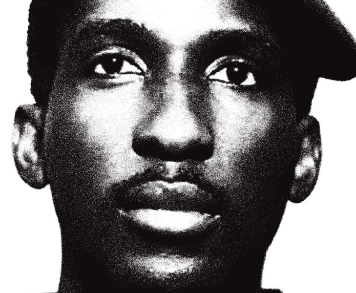 A black and white portrait of Thomas Sankara. He wears a tilted cap and looks slightly to the upper left.
